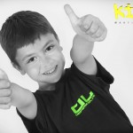 young boy two thumbs up for kidz martial arts