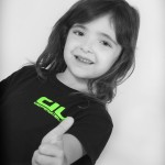 young girl 2 thumbs up for kidz martial arts