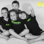 group of young children sat down and happy at kidz martial arts