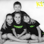 young children sat down in group hug kidz martial arts