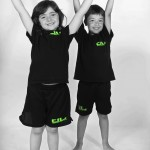young girl and boy arms up celebrating