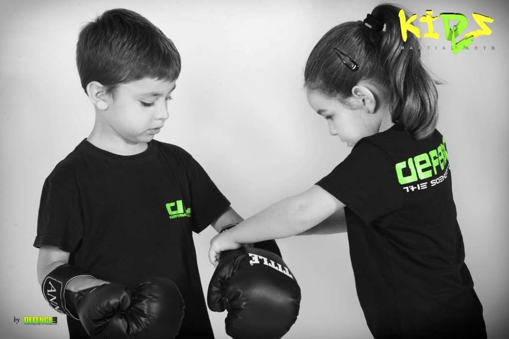 young girl helping young boy to put on gloves