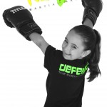 young girl with training gloves and kidz logo